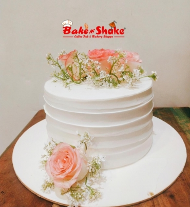 A CAKE WITH BEAUTIFUL FLOWERS